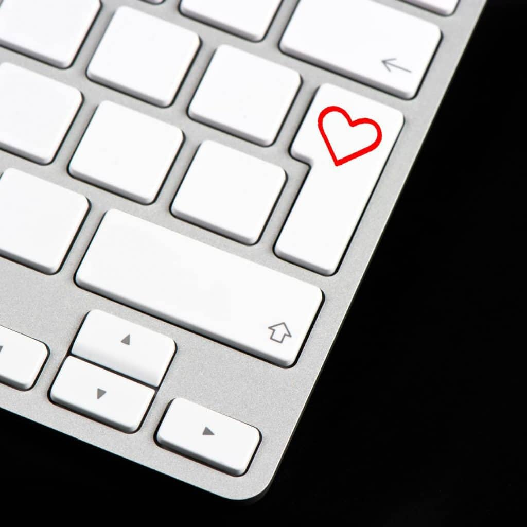 white keyboard with red heart button on black background, CX3 Marketing client projects